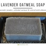 lavender oatmeal soap on a dish, text says made with lavender powder, colloidal oatmeal and colored with alkanet