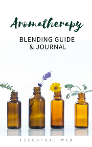 Cover image of Aromatherapy Blending Guide & Journal with amber bottles and flowers
