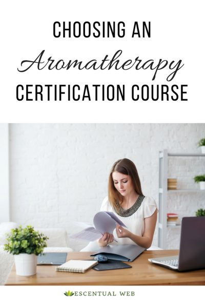 woman sitting at a desk studying papers, text says choosing an aromatherapy certification course