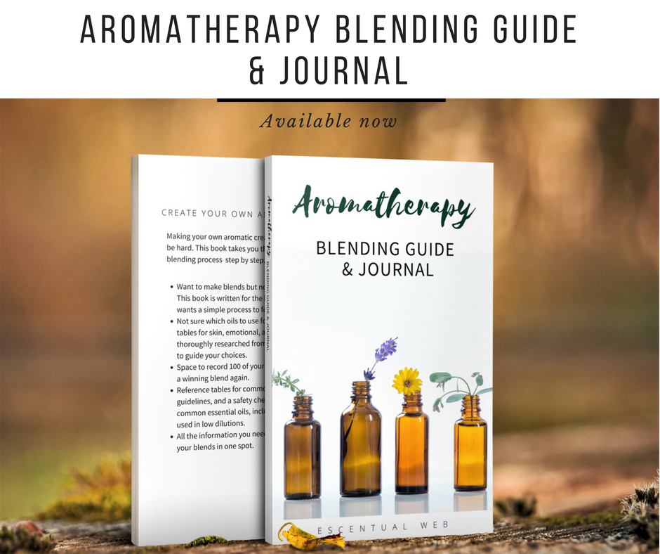 Photo of book with white cover and amber glass bottles with flowers; text says aromatherapy blending guide and journal