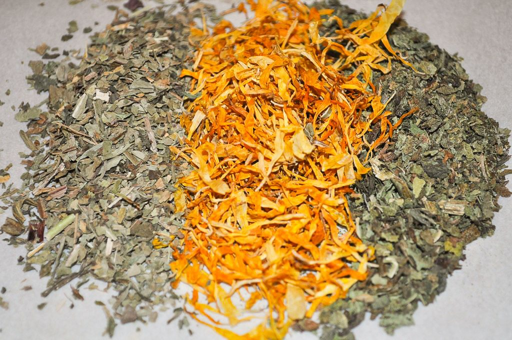 pile of dried calendula, plantain, and comfrey