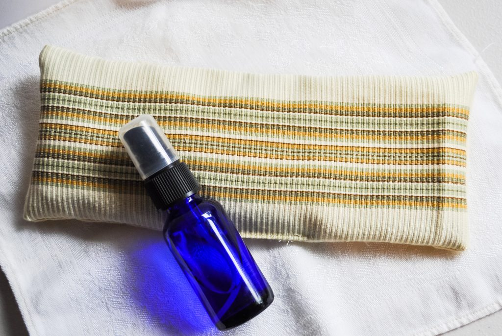 Aromatherapy pillow and a blue bottle of linen spray