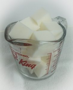 Cubes of melt and pour soap in a measuring cup